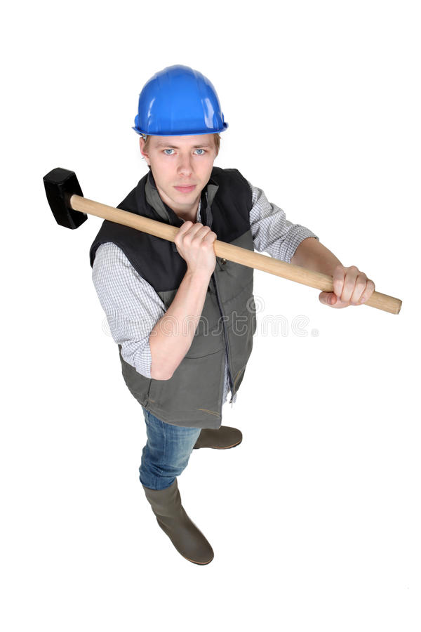 Download Man wielding heavy hammer stock image. Image of factory - 28010633
