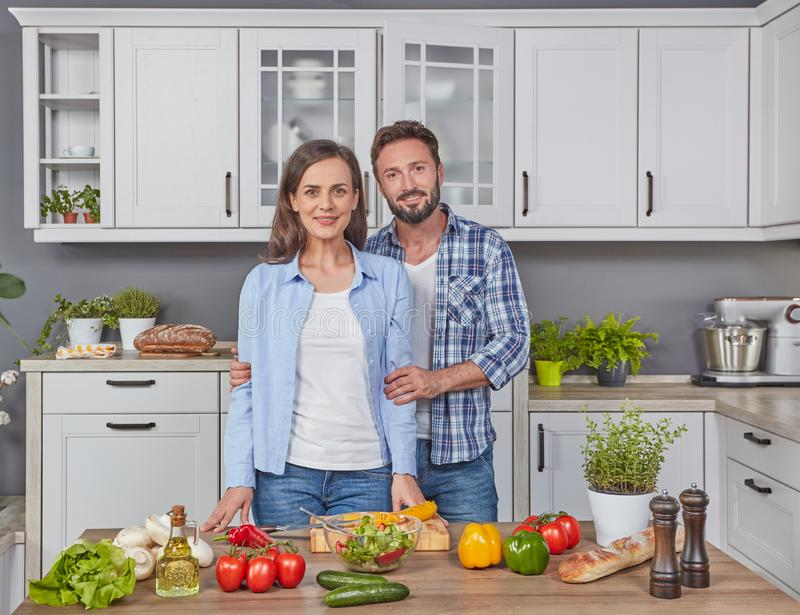 Man and wife in the kitchen royalty free stock image