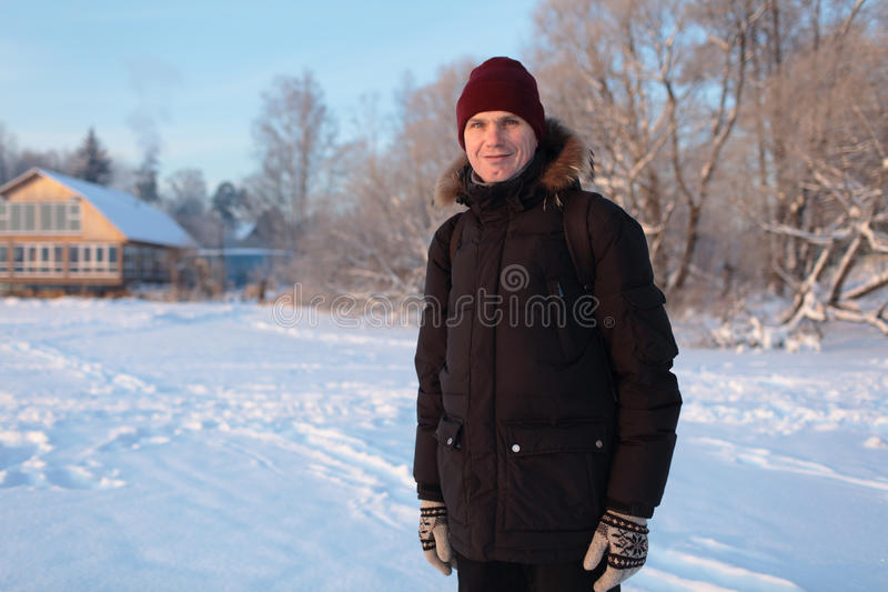 Man in a winter rural scene stock photography