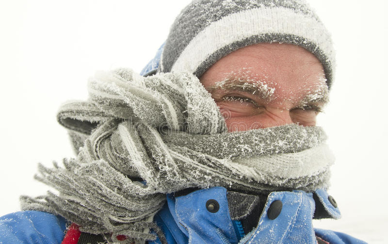 Man in winter storm stock image