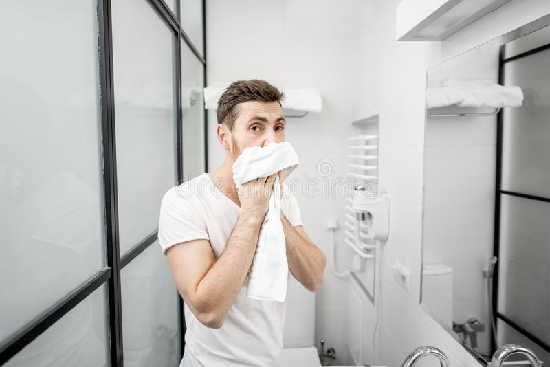 Man wiping his face with a towel stock photos