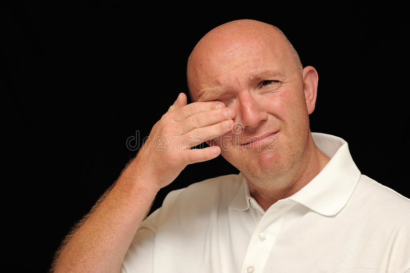 Man Wiping Tear From Eye Royalty Free Stock Images
