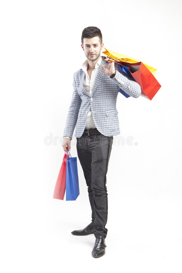Free Man With Shopping Bags Royalty Free Stock Photo - 26038415