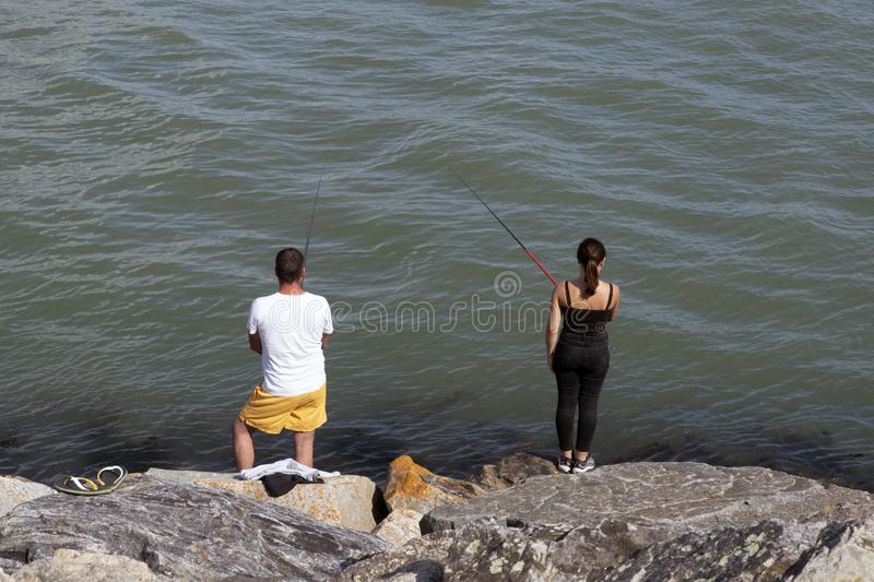 Angling at the water`s edge royalty free stock photography
