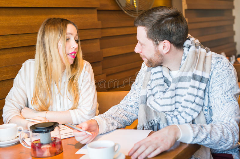 Man and woman arguing indoors. Man and women arguing about home finances stock photo