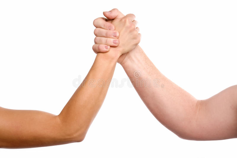 Man and woman arm wrestling. A man and woman with hands clasped arm wrestling royalty free stock images