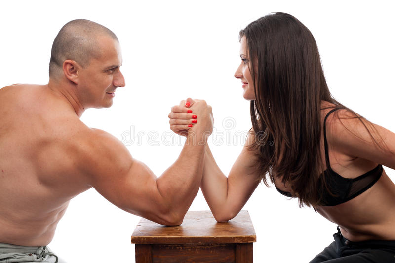 Download Man And Woman Arm Wrestling Stock Photo - Image of adult, couple: 15424042