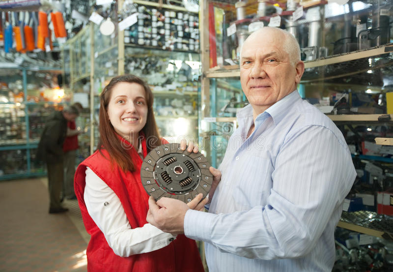 Man and woman in auto parts store stock images