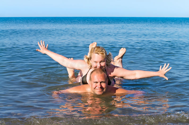 Download Man And Woman Of Average Years Play Sea As Children Stock Photo - Image: 41335336