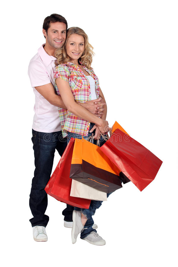 Download A Man And A Woman With  Bags Stock Photo - Image: 23859268