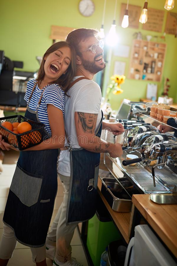 Man and woman barista working at cafe store stock image