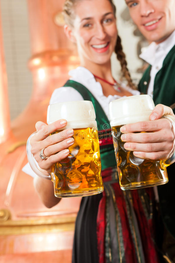 Download Man And Woman With Beer Glass In Brewery Stock Photo - Image: 22772600