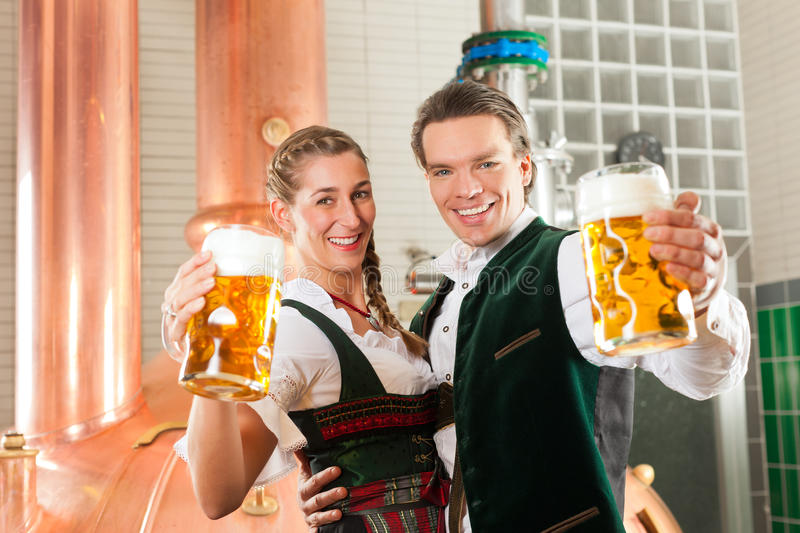Download Man And Woman With Beer Glass In Brewery Royalty Free Stock Photography - Image: 22772627