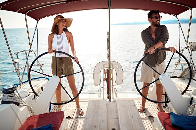 Man and woman on the boat enjoy on summer day and traveling stock photos