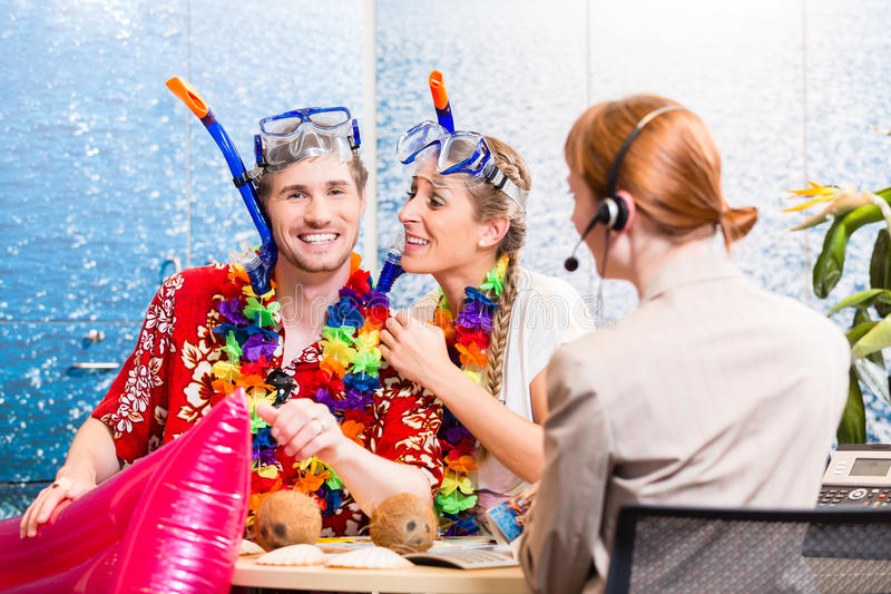 Man and woman booking beach holiday stock images