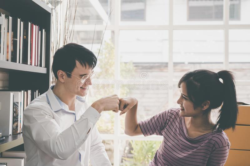 Business couple fist bump hand together for team w. Man and women business couple fist bump hand together for team work royalty free stock image
