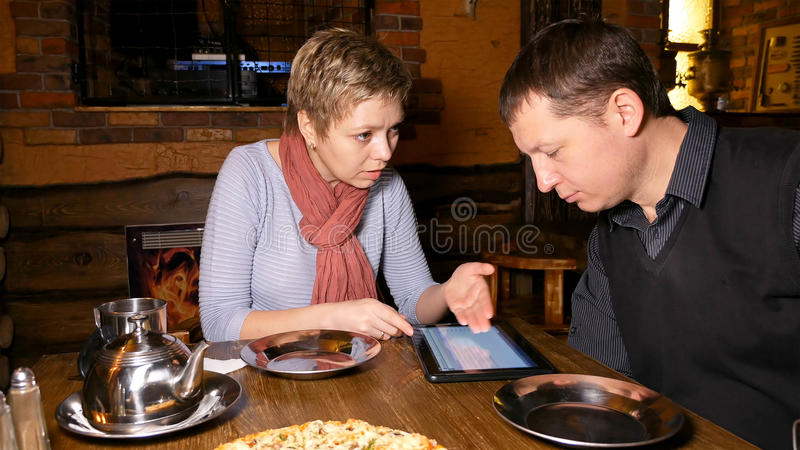 Man and woman business partners chatting in cafe stock photography