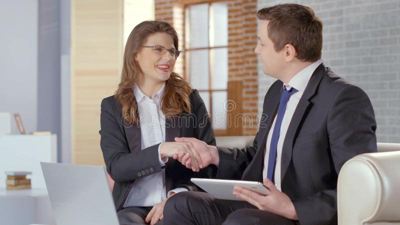 Man and woman business partners shaking hands, concluding agreement, deal royalty free stock photos