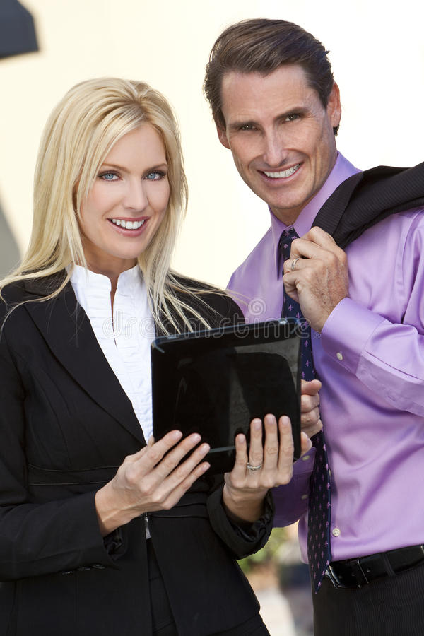Man & Woman BusinessTeam Using Tablet Computer. Man and woman, businessman and businesswoman team using tablet computer royalty free stock photography