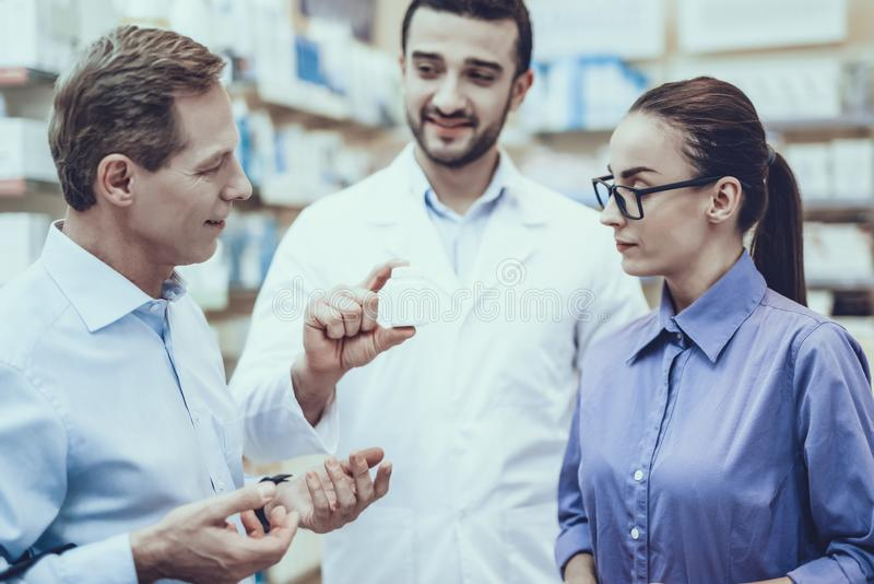 Man and woman buys a medicaments in pharmacy stock photography