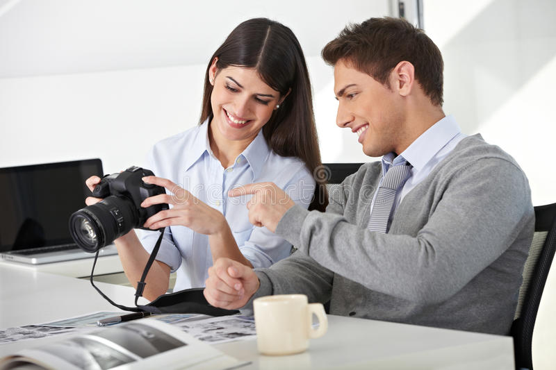 Download Man And Woman With Camera In Office Stock Image - Image: 27003497