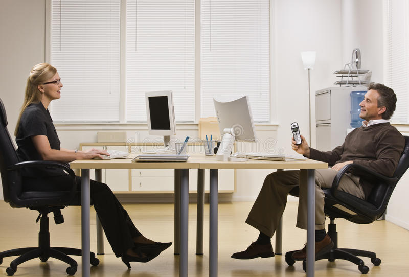 Download Man And Woman Chatting In Office Stock Photo - Image of chair, midlife: 10011452