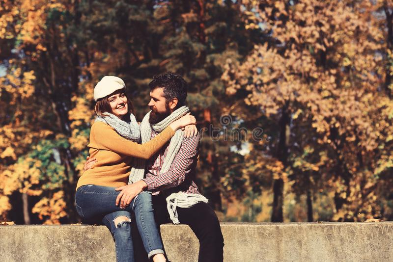 Man and woman with cheerful faces on autumn trees background royalty free stock photos