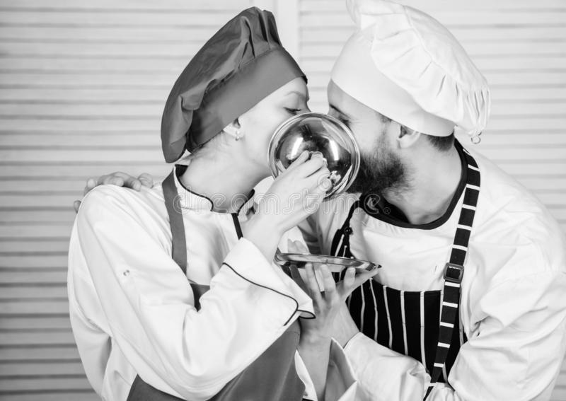 Man and woman chef in restaurant behind metallic tray. secret ingredient by recipe. cook uniform. Family cooking in stock image