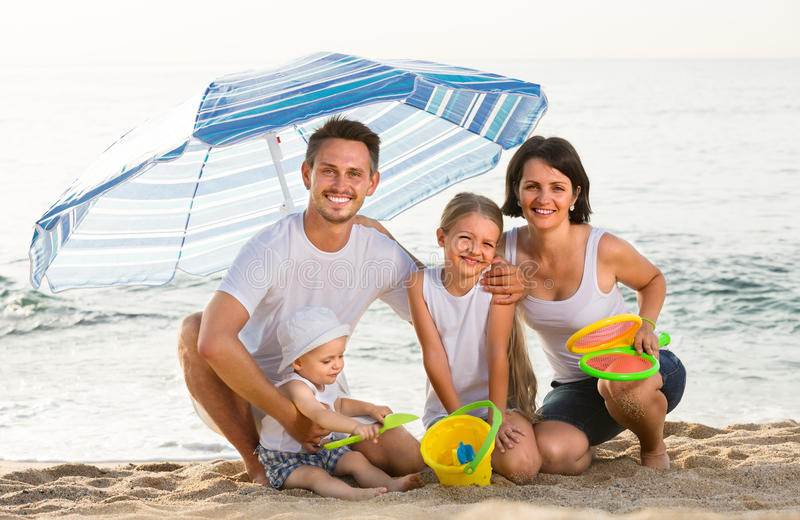 Man and woman with children sitting royalty free stock images