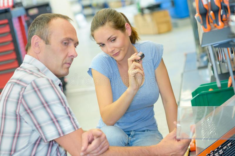 Man and woman choosing in hardware store royalty free stock image