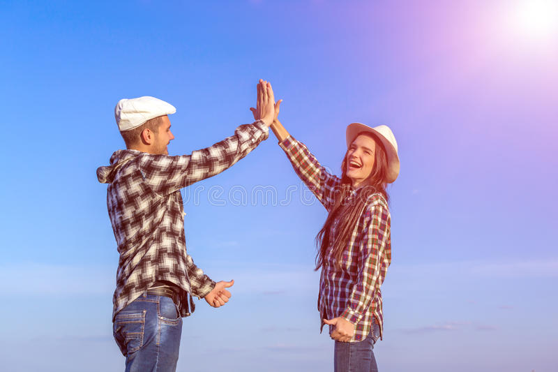 Man and Woman Clapping Hands Each Other royalty free stock photography