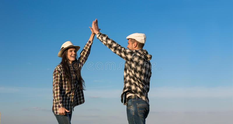 Man and Woman Clapping Hands Each Other royalty free stock image