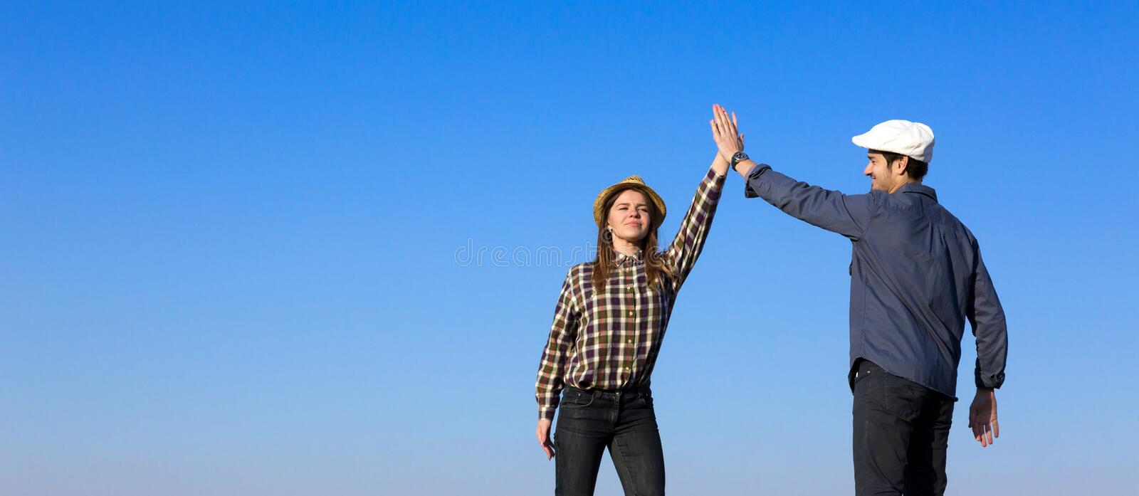 Man and Woman Clapping Hands Each Other stock photography