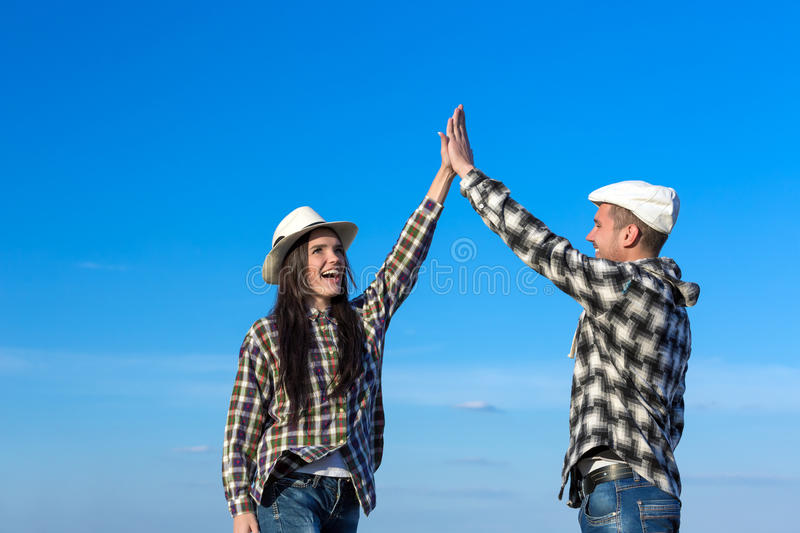 Man and Woman Clapping Hands Each Other stock image