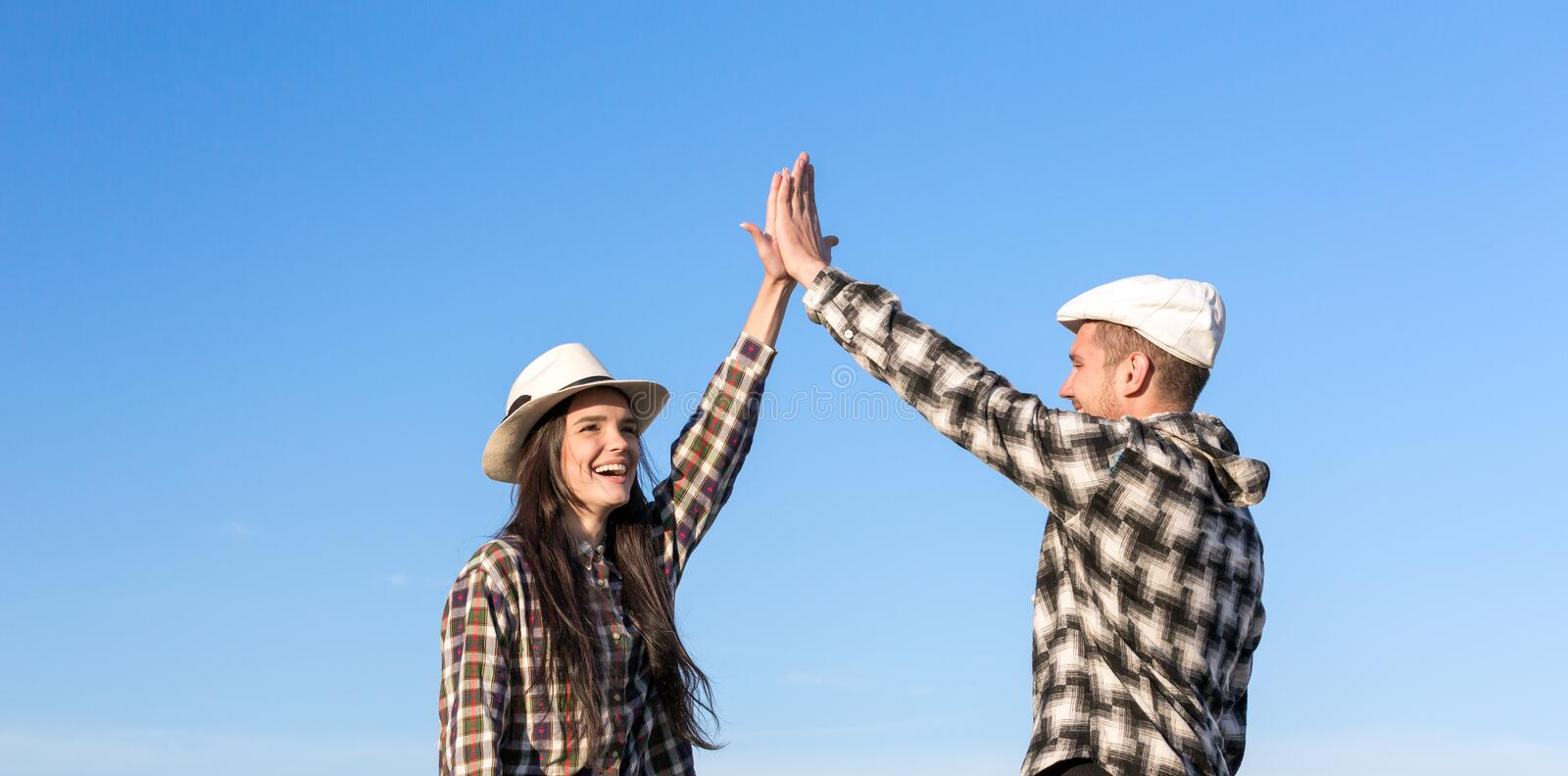 Man and Woman Clapping Hands Each Other stock images