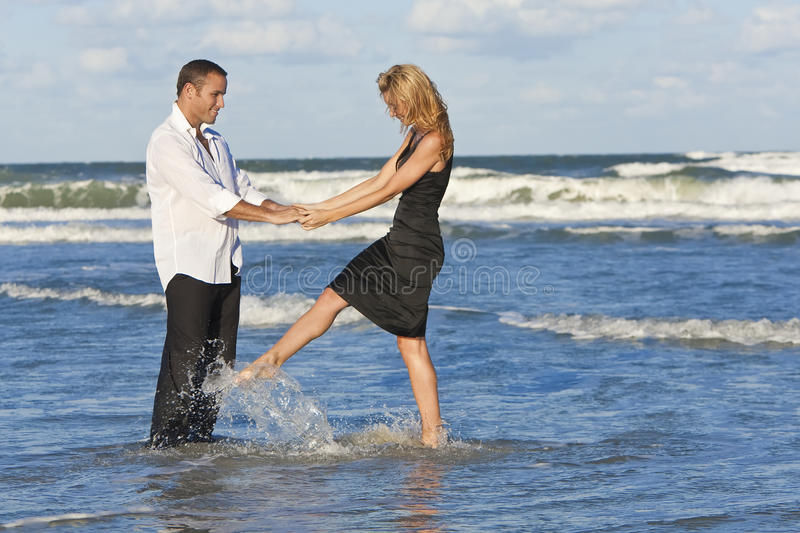 Man and Woman Couple Having Fun Dancing On A Beach royalty free stock image