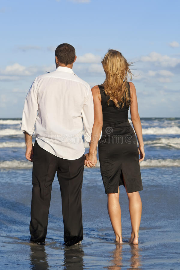 Download Man And Woman Couple Holding Hands On A Beach Stock Photo - Image: 12426038