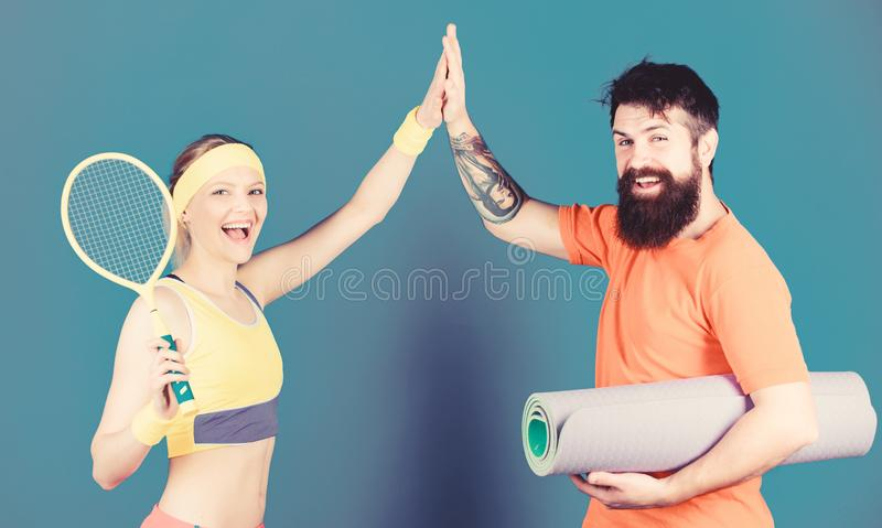 Man and woman couple in love with yoga mat and sport equipment. Fitness exercises. Workout and fitness. Girl and guy royalty free stock photo