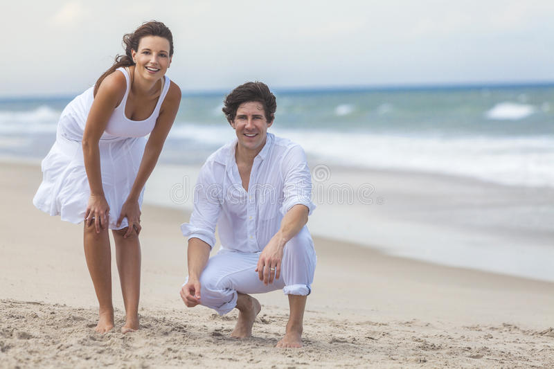 Download Man & Woman Couple Together On A Beach Stock Image - Image of ocean, women: 26053069