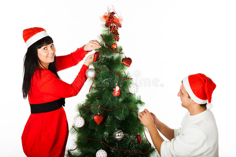 Download Man And Woman Decorating Christmas Tree Stock Photo - Image: 28064848