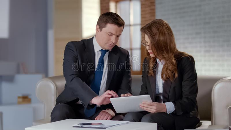 Man and woman discussing business matters in office, planning startup strategy stock photo