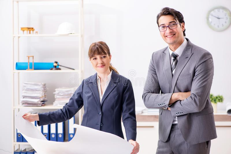The man and woman discussing construction project stock photo