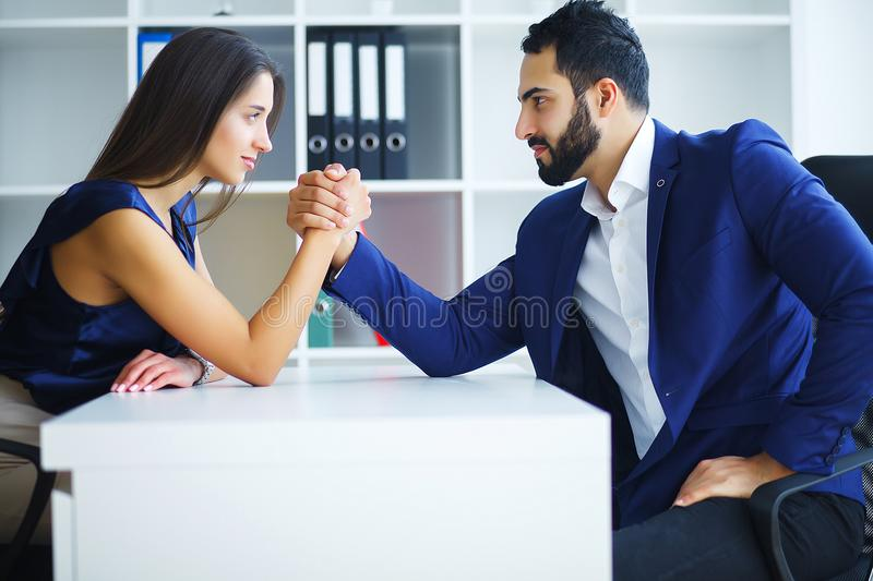 Man and woman doing arm wrestling. Man and women doing arm wrestling stock images