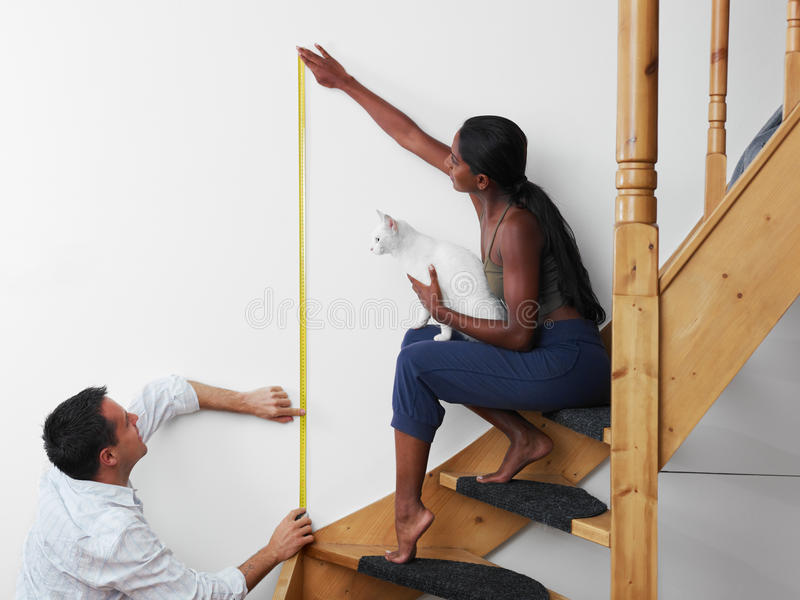Man and woman doing diy work at home stock photo