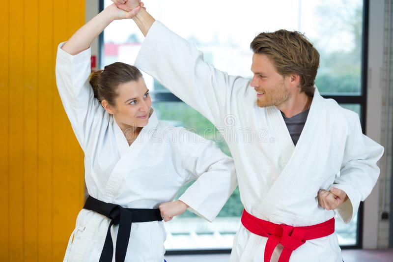 Man and woman doing karate stock images