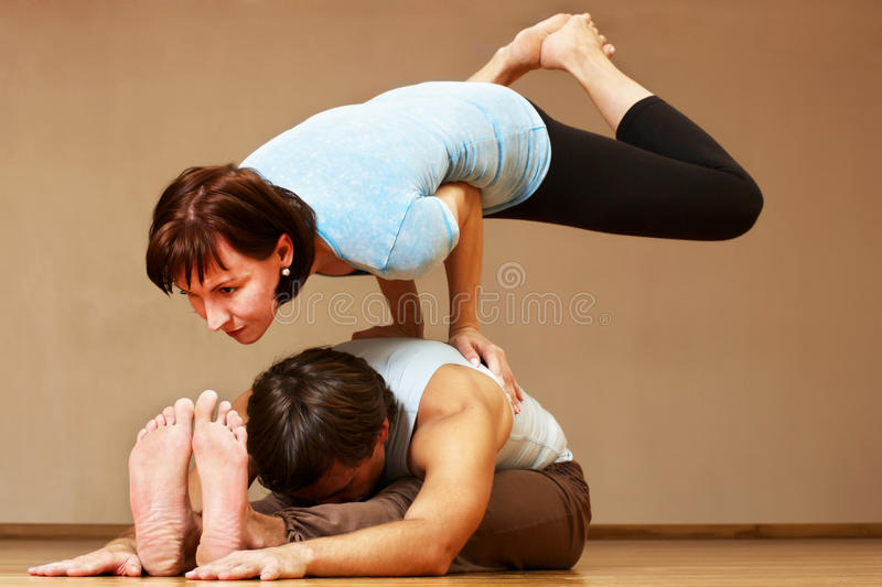 Man and woman doing yoga practice