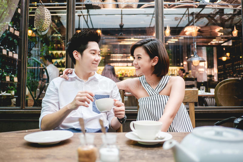 Man and woman drinking a cup of tea stock image