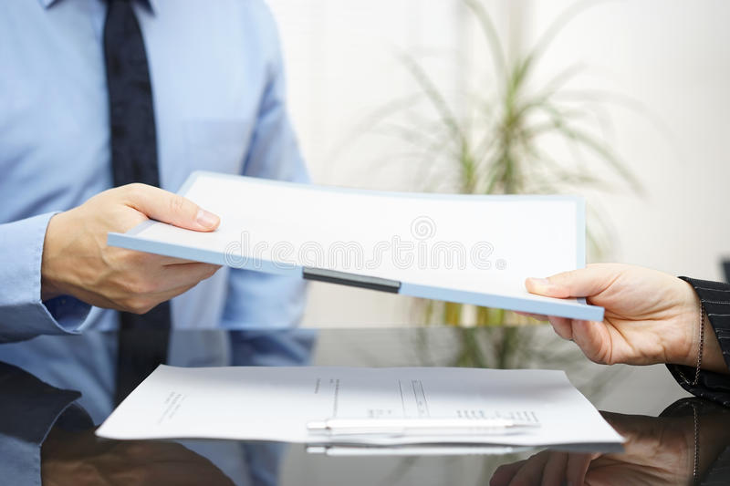 Man and woman are exchanging contract or document royalty free stock images