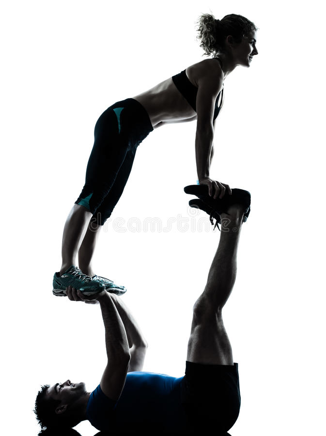 Man woman exercising acrobatic workout fitness silhouette stock photography