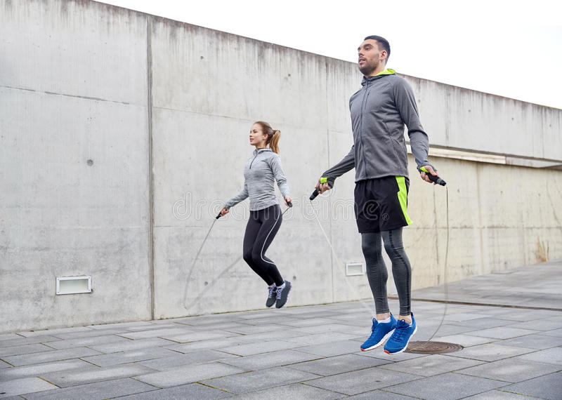 Man And Woman Exercising With Jump-rope Outdoors Stock ...